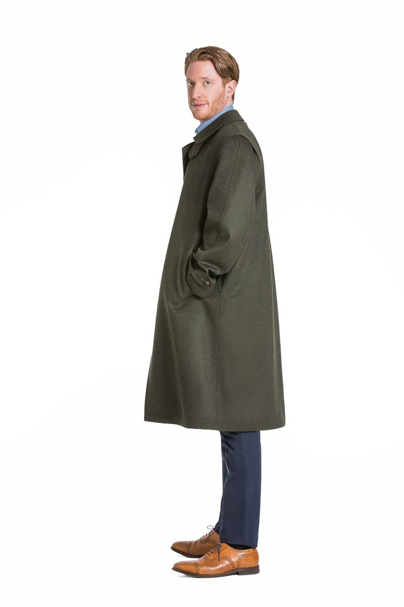 profile view of a young man wearing a Robert W. Stolz green loden coat with removable zip out lining