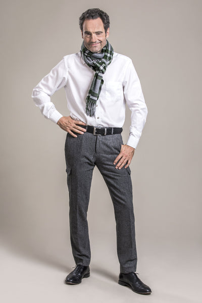 a 50 year old man wearing an austrian wool scarf and austrian loden wool pants