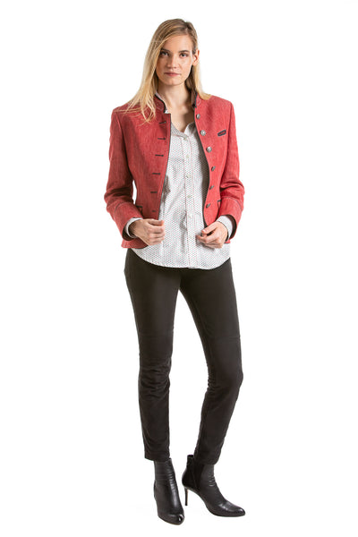 young blonde women wearing a red linen riding jacket