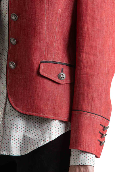 portion of a young blonde women wearing a red linen riding jacket