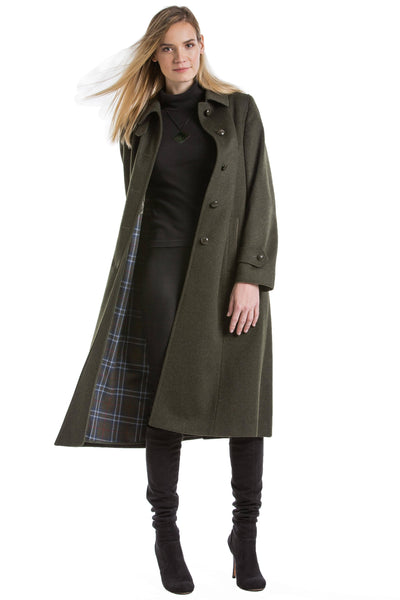 30 year old blonde woman wearing a Robert W. Stolz Austrian loden wool coat