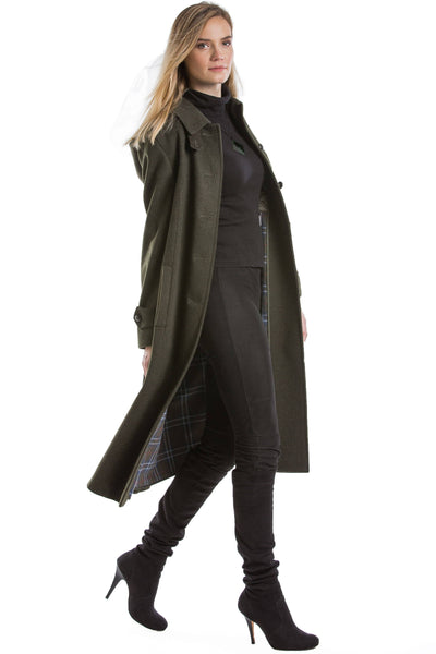 30 year old blonde woman wearing a Robert W. Stolz german loden wool coat