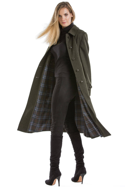 30 year old blonde woman wearing a luxury Robert W. Stolz Austrian loden wool coat