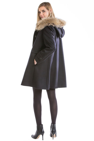 a german loden coat worn by a beautiful blonde girl