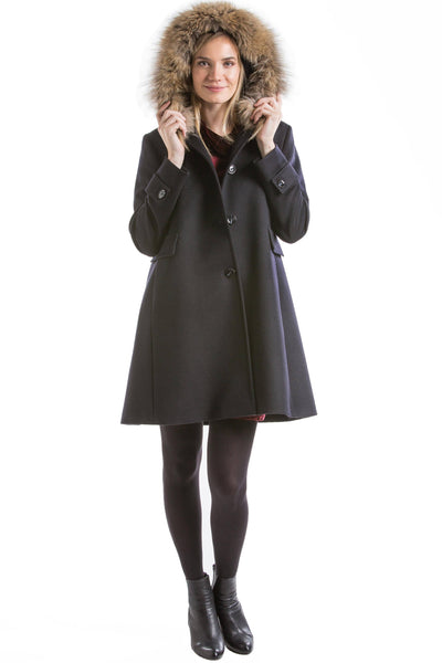 30 year old blonde woman wearing a Robert W. Stolz Austrian loden wool coat with the hood up