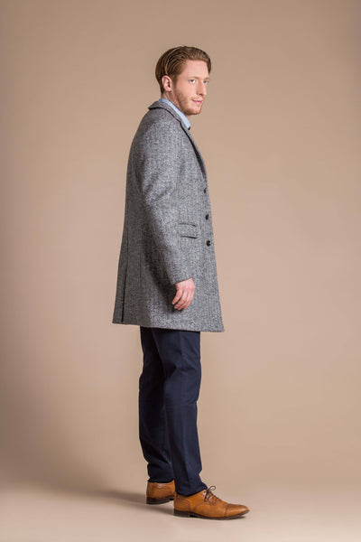 man wearing a Robert W. Stolz boiled wool herringbone weave overcoat