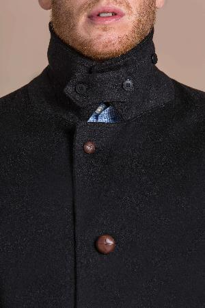 man wearing a pure cashmere overcoat
