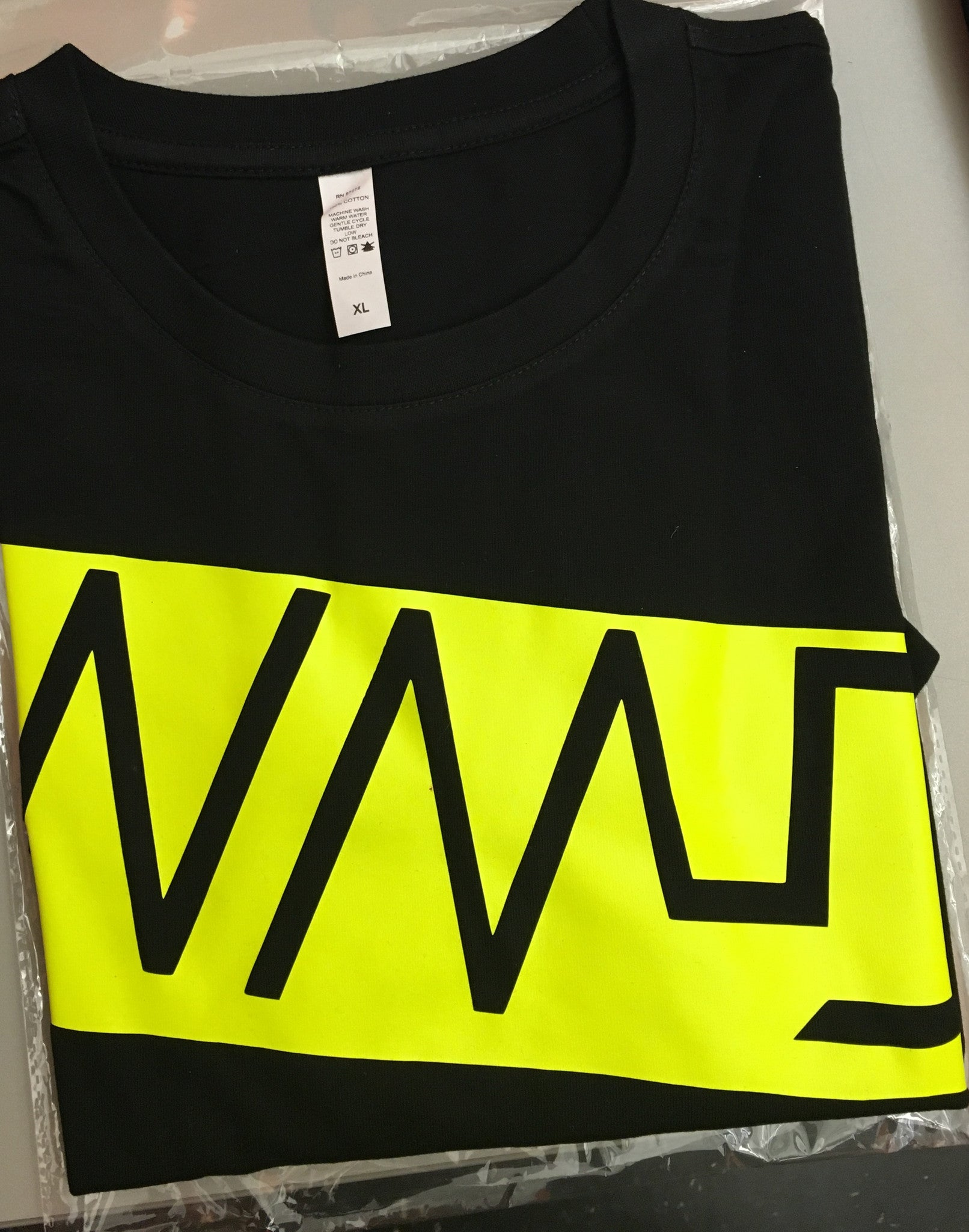 WMD-Yellow outline on black short sleeve shirt