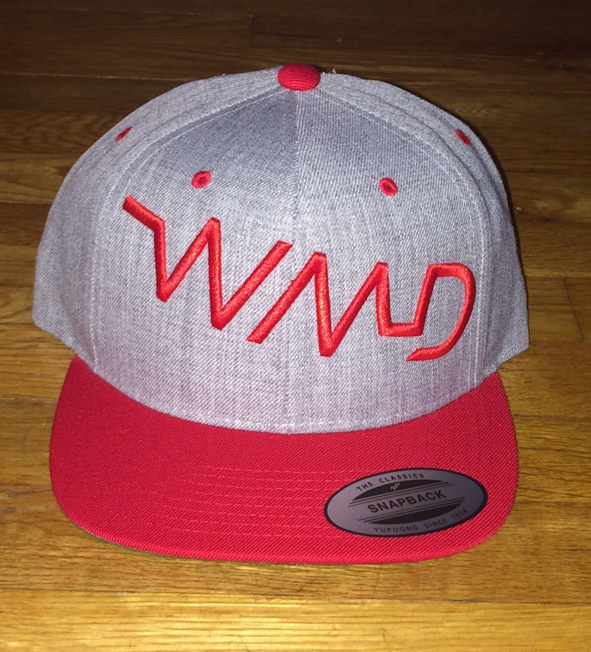 WMD- Red on grey snap back