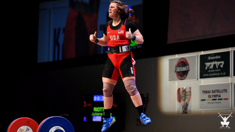 Juliana Riotto celebrates after clean and jerking 114 kg.