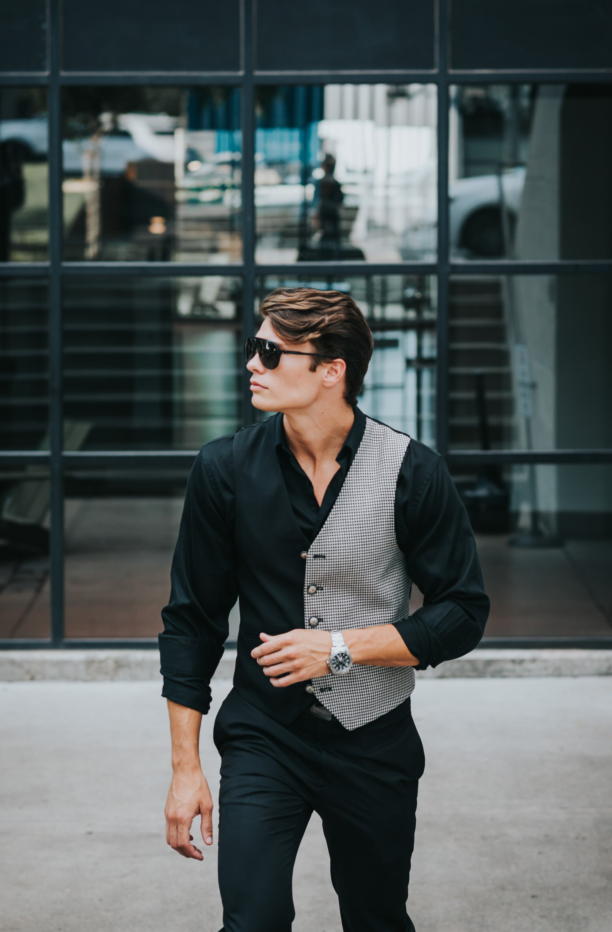 man with sunglasses wearing a black houndstooth wool front men's vest