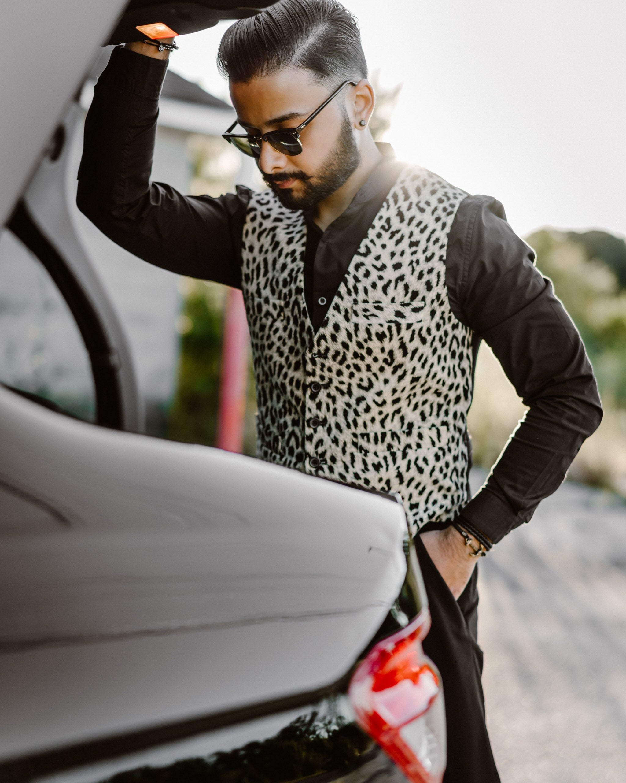 man wearing a leopard print velvet front single breasted men's vest with black buttons