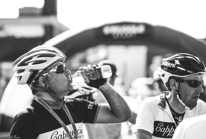Cyclists drinking Harrogate Spring Water on Struggle Dales Sportive in Yorkshire
