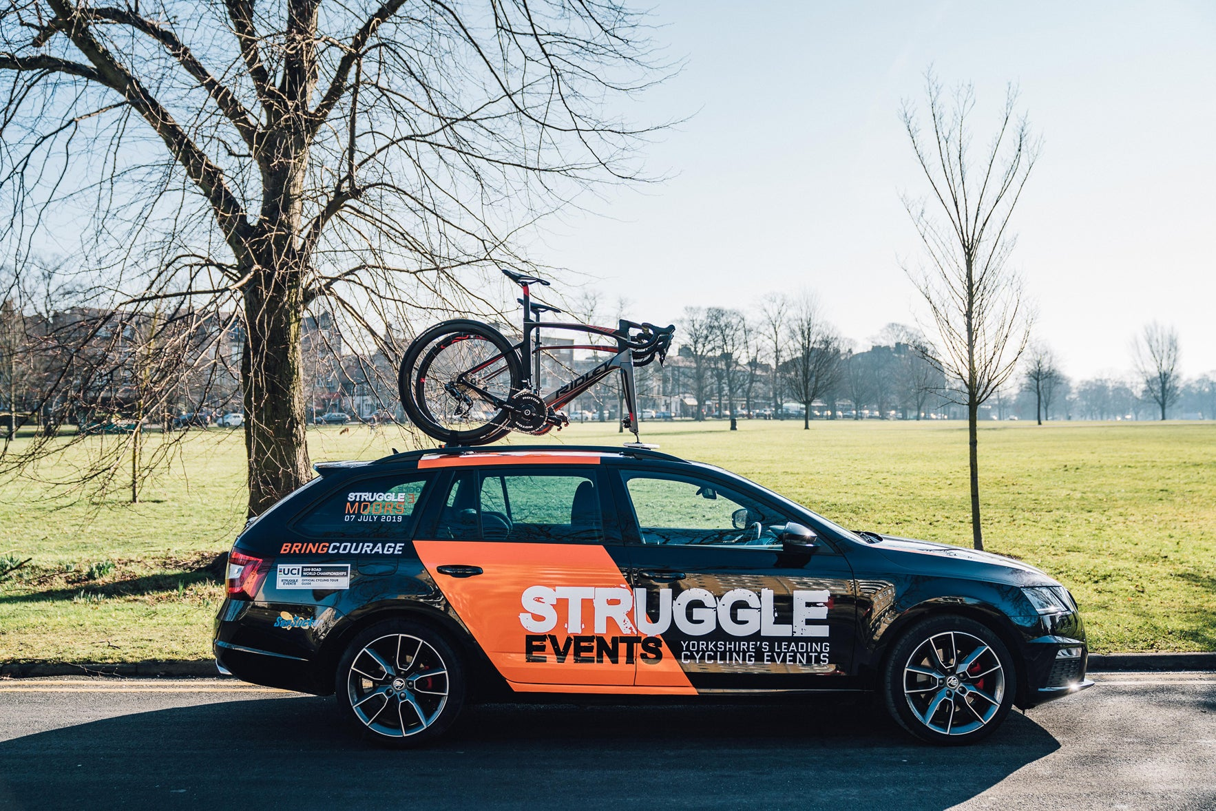 Mechanical support car for corporate cycling event