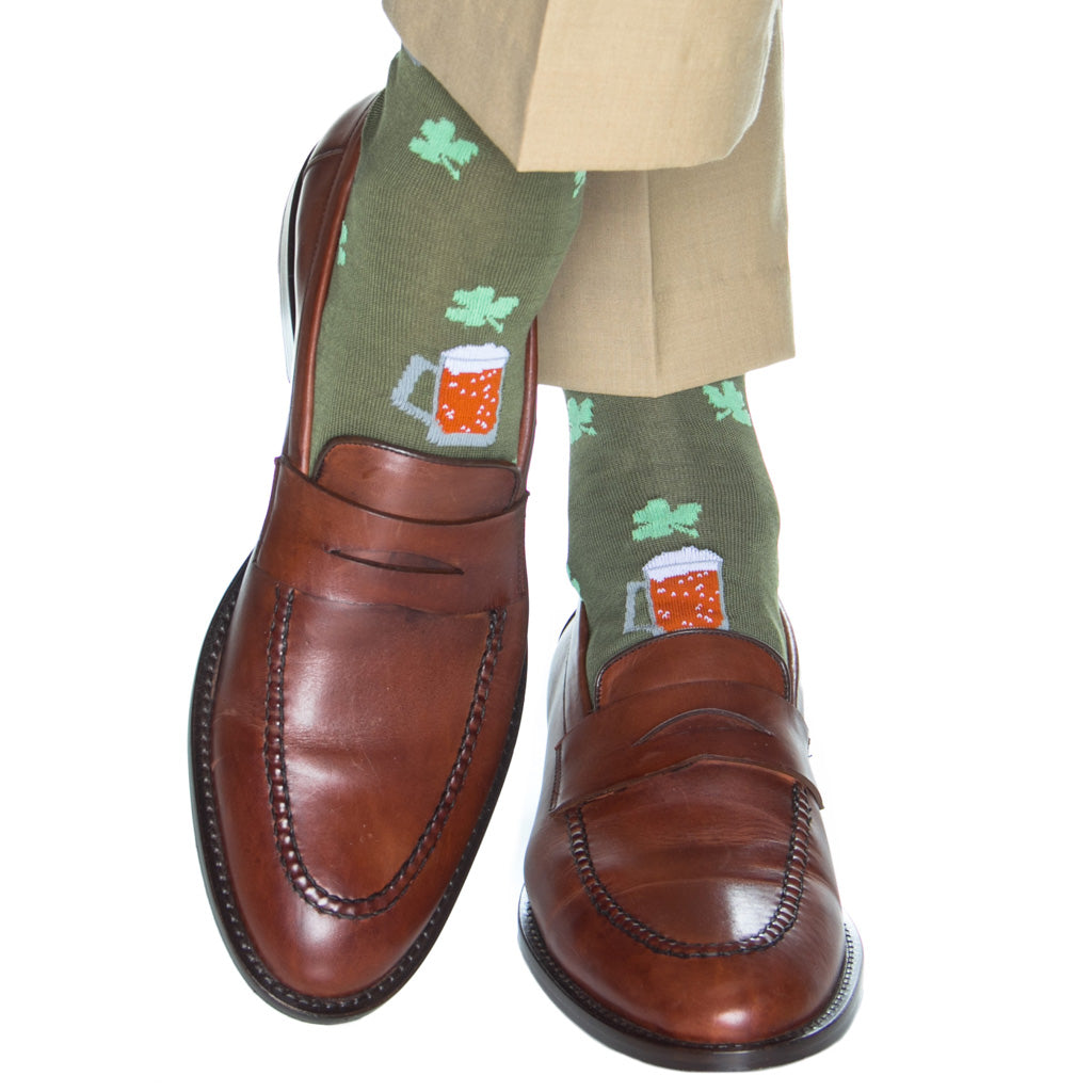 mid-calf pine green sock with beer mug and clover