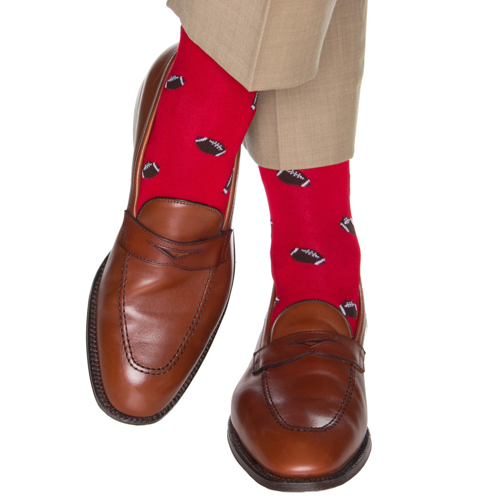 over-the-calf red sock with footballs