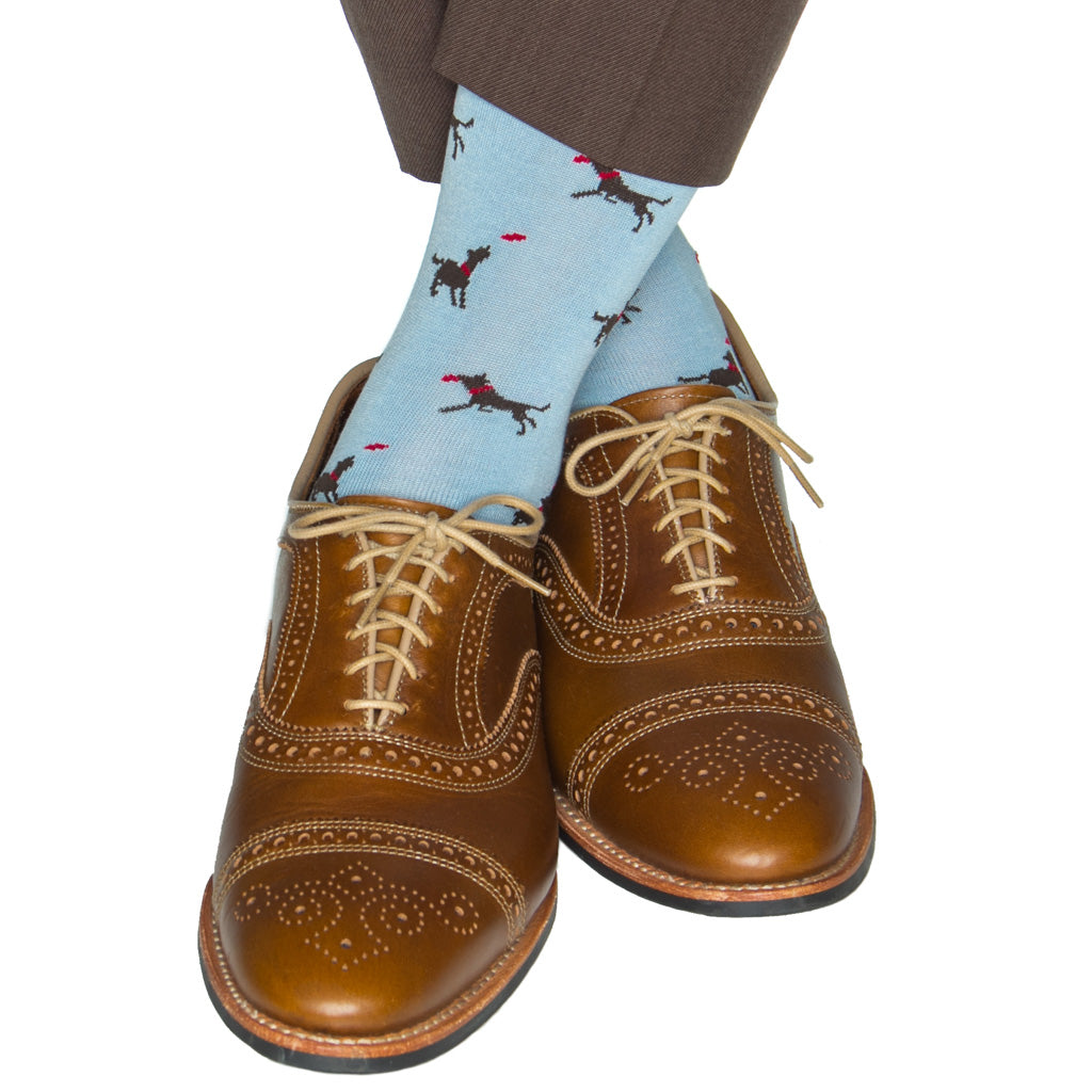sky blue sock with brown dog catching a frisbee cotton