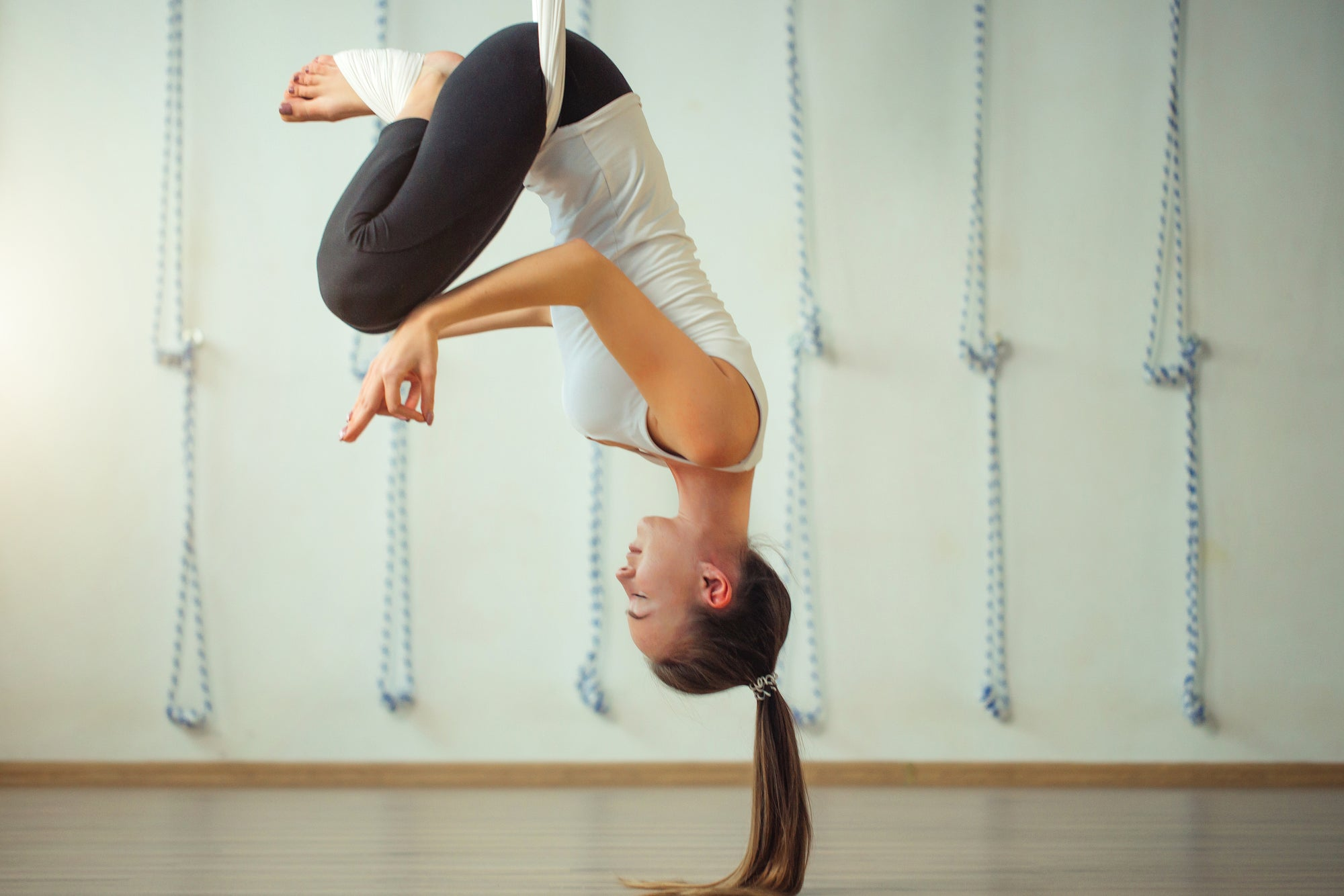 The Best Aerial Yoga Poses to Relieve Back Pain