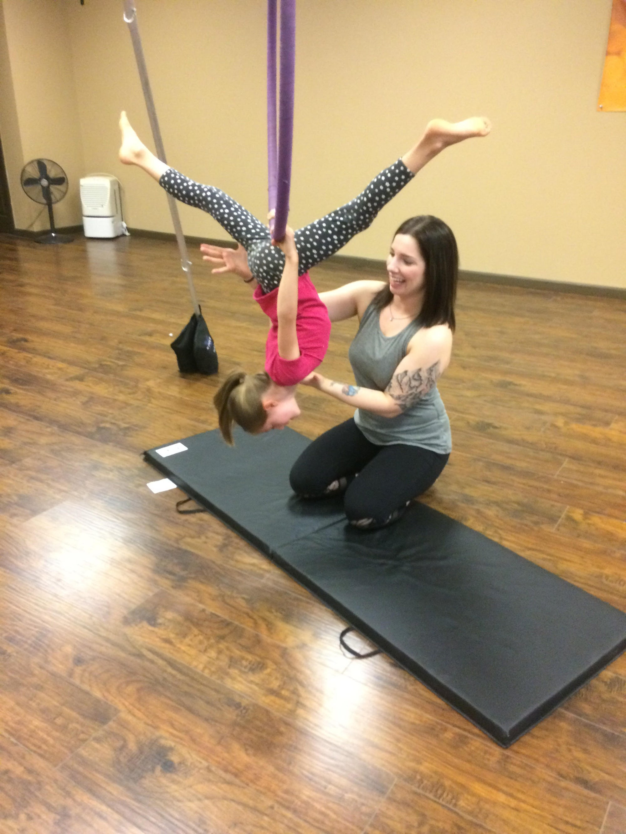 Jessalyn Hoffman teaching a child in Ombre Yoga Hammock