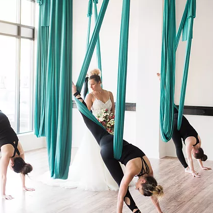 Aerial Yoga Bachelorette Party Bride in Blue Hammock