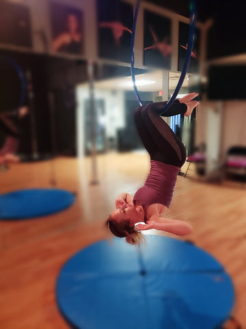 Girl doing an Inverted Sit Up on her Aerial Hoop