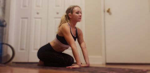 Girl doing a forearm stretch