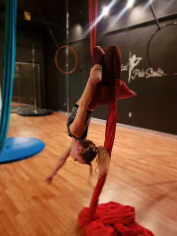 Girl doing a Lean Back in our Red Aerial Silks