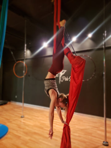 Girl doing a MaidenHead in our Red Aerial Silks