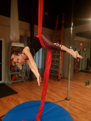 Girl doing a Hip Key Pose in our Red Aerial Silks