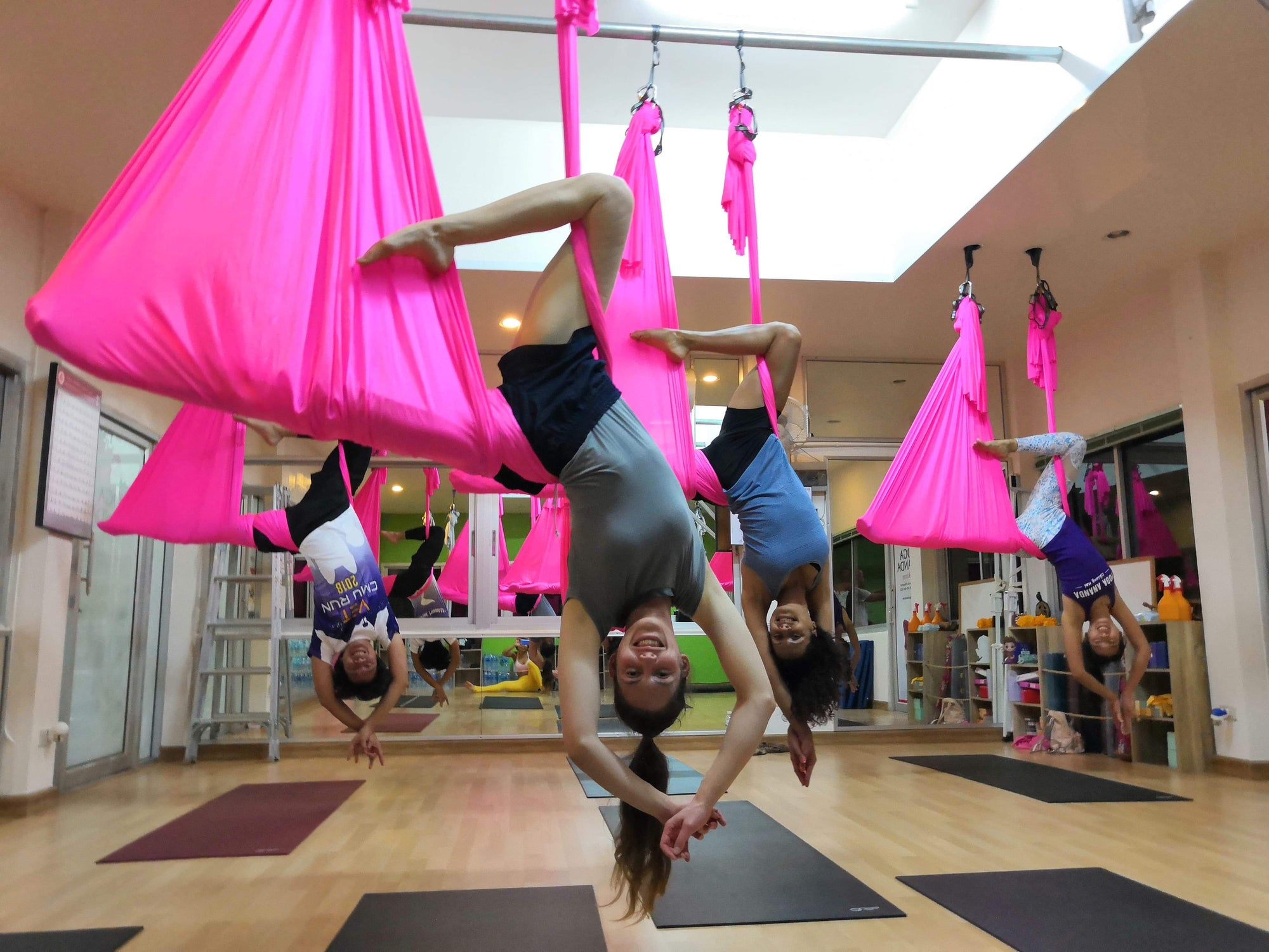 Ladies in Aerial Yoga Class Pink Yoga Hammock