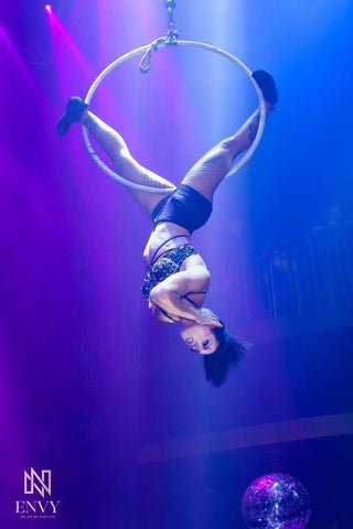 Girl hanging upside down on an Aerial Hoop or Lyra