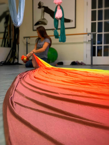 Sunset Ombre Fabric laid on the floor