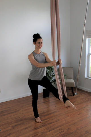 Girl doing a Standing Leg Extension