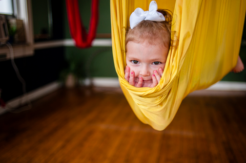 Child in Yellow Yoga Hammock