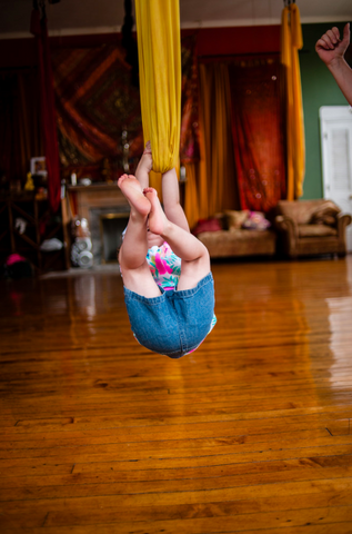 Child Climbing on Yellow Aerial Hammock