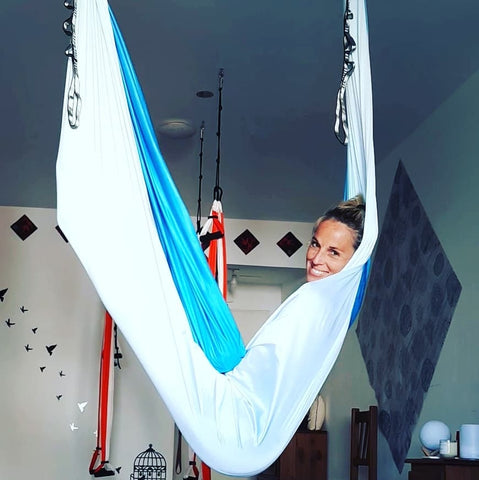 Girl relaxing on her White and Blue Aerial Hammock