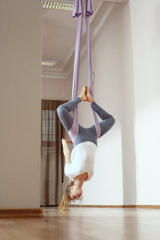 Girl doing an Inverted Butterfly in an Aerial Hammock