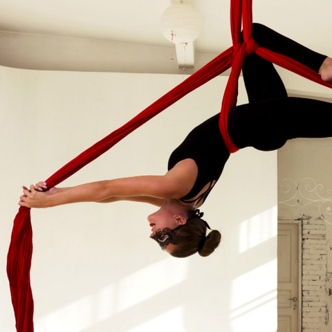 lady in red aerial silks