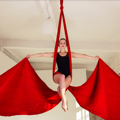 girl in red aerial silks