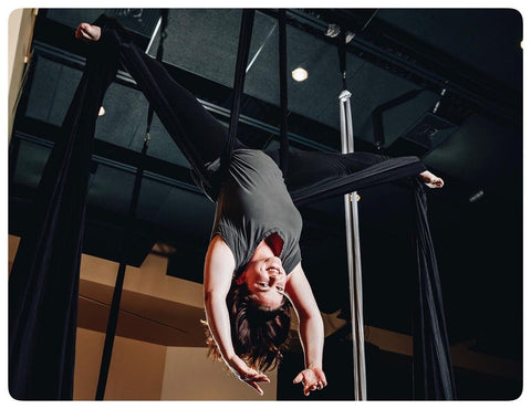 Girl doing an Aerial Inversion on our Black Aerial Silks