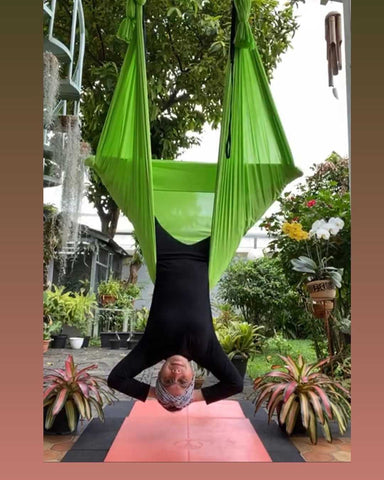Girl doing an inversion on her Green Aerial Hammock