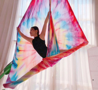 Woman on Rainbow Tie Dye erial Silks Aerial Yoga Fabric - Uplift Active