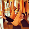 Woman on Orange Yoga Hammock Studio Set Up
