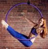 Woman Hanging on Black X-Pole Pro Hoop (25mm width) - Double Point Lyra - Aerial Yoga Gear Uplift Active