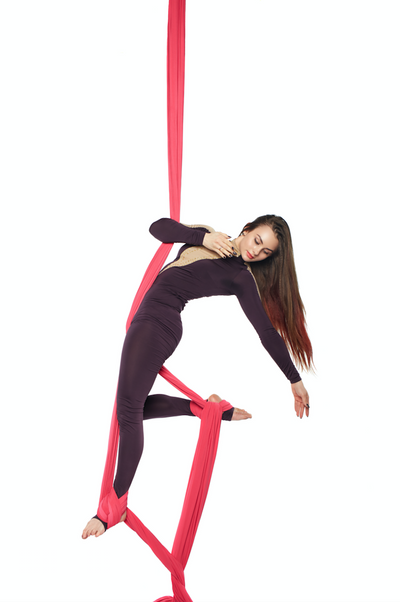 Woman on Red Aerial Silks Set with All Hardware - Aerial Yoga Gear Red Aerial Silks Set with Hardware Uplift Active