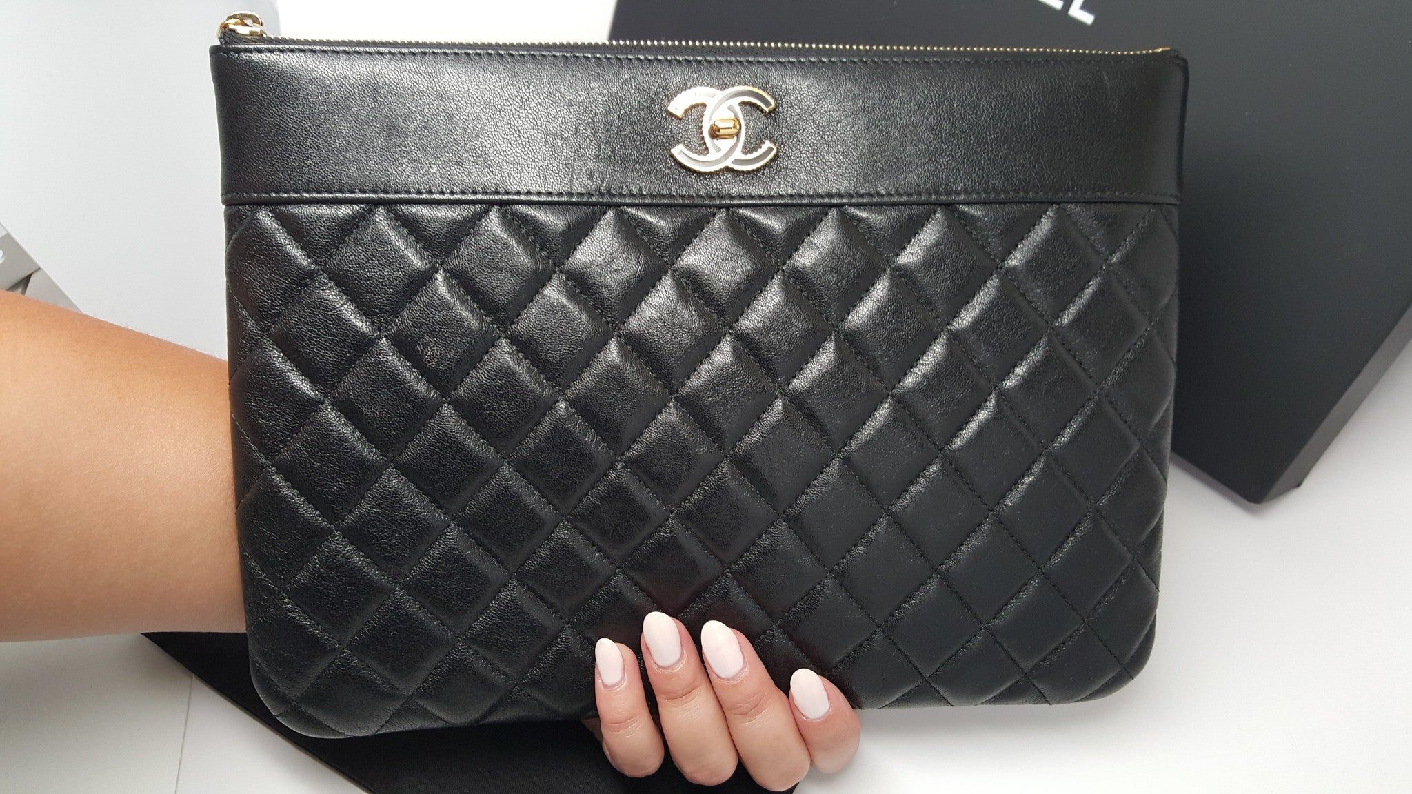 CHANEL QUILTED MEDIUM O CASE IN LAMBSKIN LEATHER