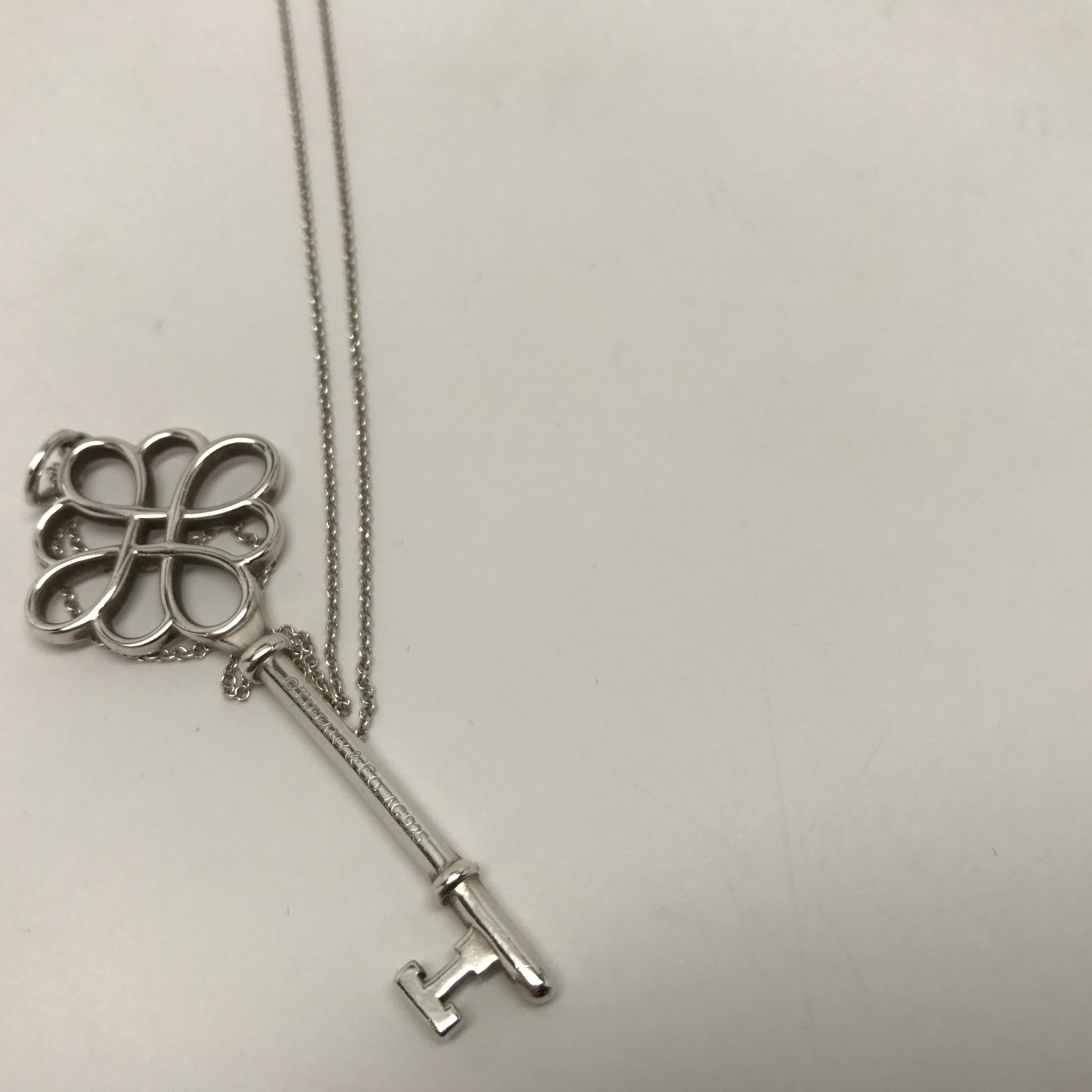 TIFFANY & CO. KNOT KEY PENDANT WITH CHAIN