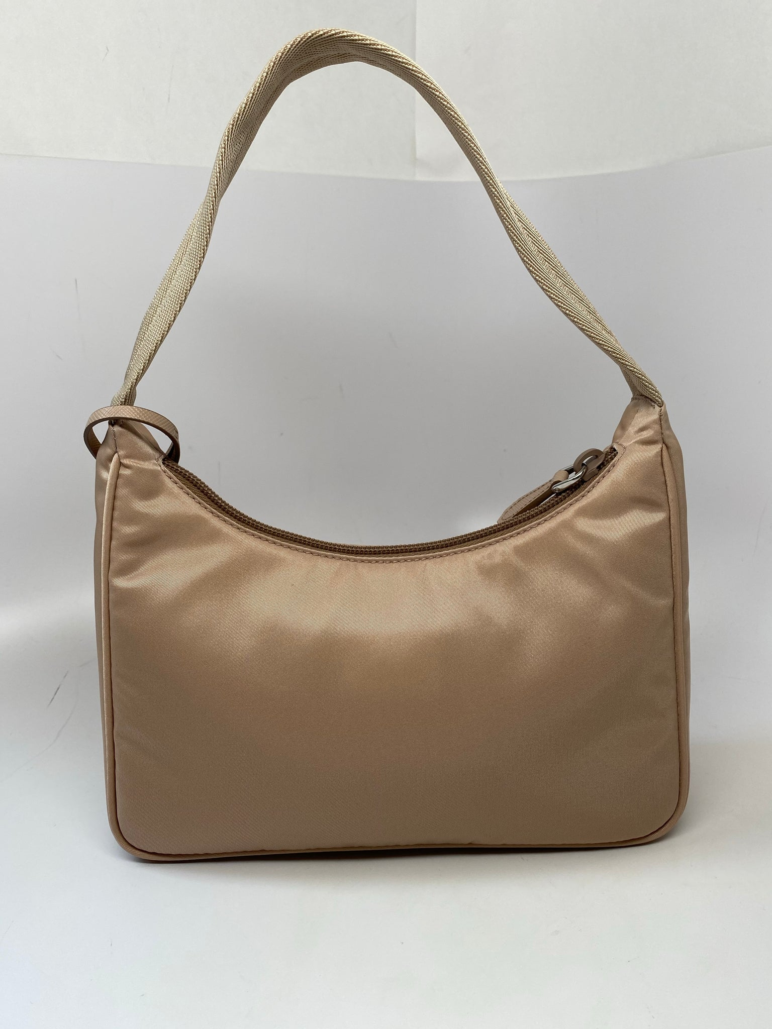 PRADA RE-EDITION 2000 NYLON MINI BAG IN CAMMEO BEIGE