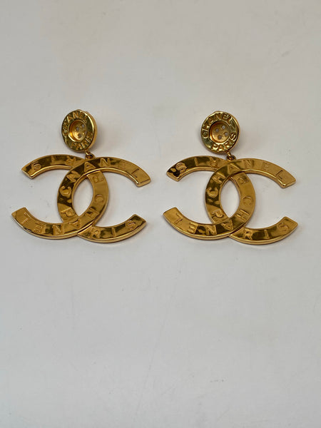 CHANEL METAL LARGE PARIS BUTTON CC DROP EARRINGS