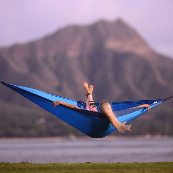 Yoga instructor Kathryn McCann rests in a hammock while overlooking Diamond head in Oahu, Hawaii.